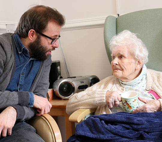 Hartley House Residential Home happy resident with carer